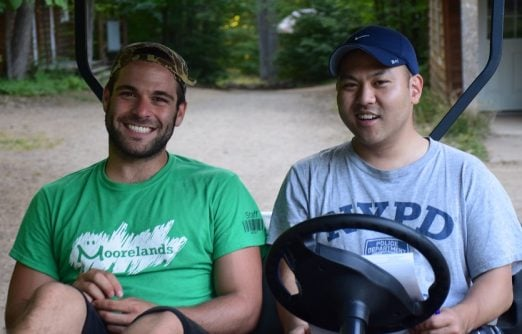 Mike (right) as a volunteer at camp