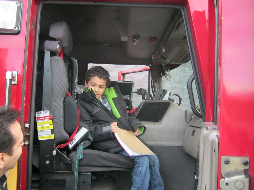 BLAST participants take a seat in the Fire Truck.