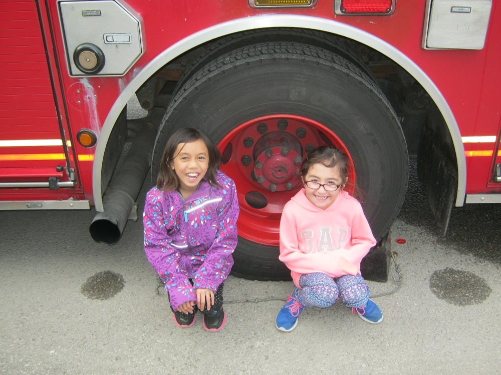 BLAST girls marvel at the Fire Truck's enormous wheels!