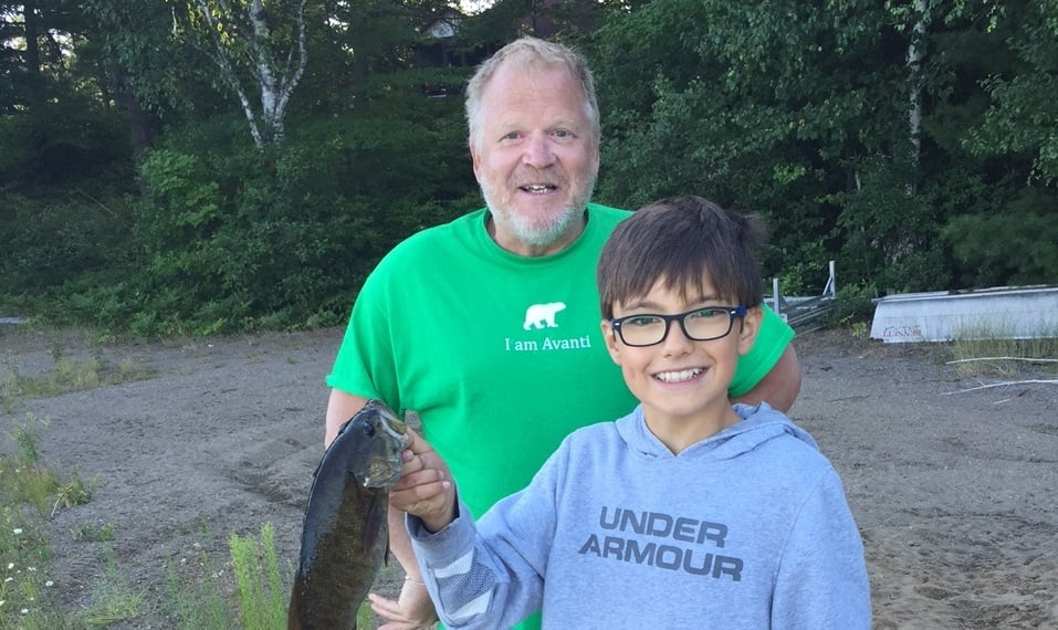 John, with a friend's son, after a successful fishing trip!