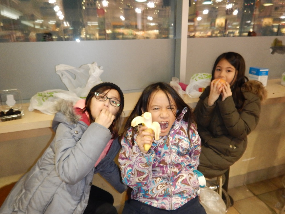 Life skills lessons at BLAST: taking a break with a healthy snack selected from the store.