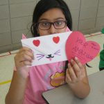 A BLAST participant makes a caring card for her leader