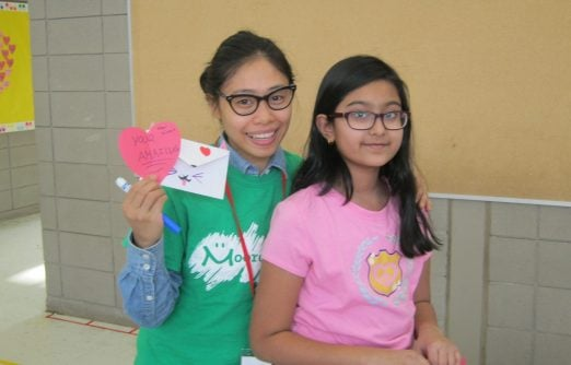 A BLAST participant shows caring by making Zinnia a card for valentine's day.