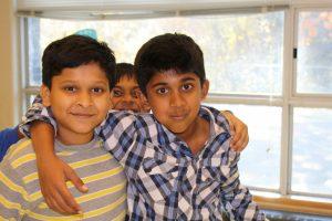 three boys posing for photo