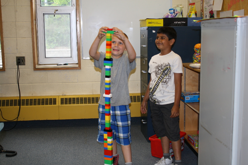 Kids building a towers of lego