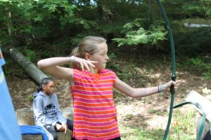 Girl at camp practising archery