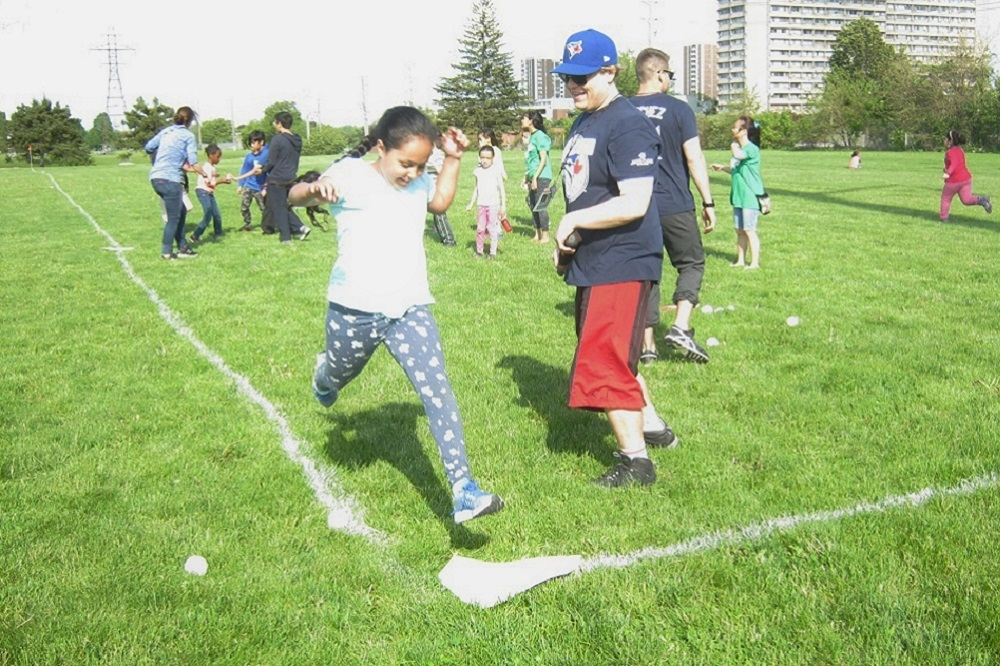 image Girl runs the bases at baseball field