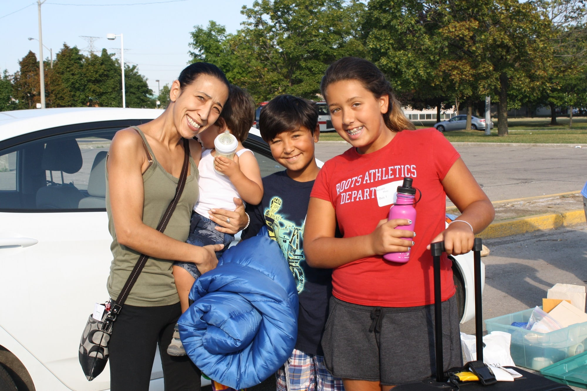 at the bus to camp mom and kids