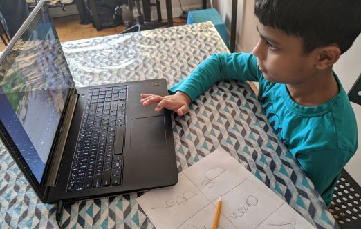 Moorelands Kids - a child at his laptop takes part in our online programs