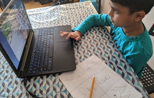 after-school programs online this fall - a young boy at a laptop takes part in our online programs
