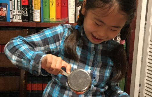 Executive Directors' Report 2020 - a child takes part in a science experiment at home as part of our online programs